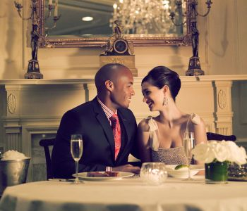 Romantic couple sharing dinner at The Lafayette Restaurant