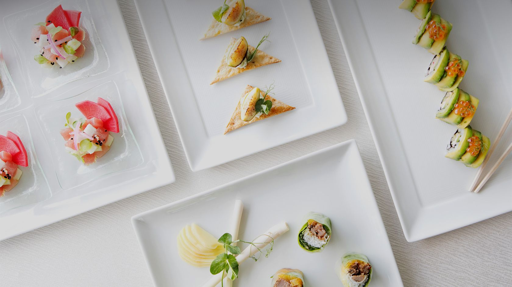 white plates of appetizers on a table
